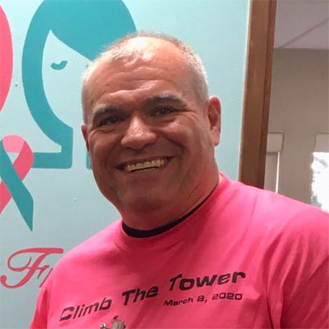Baron Robison, Executive Director of Kickin' Cancer wearing a pink shirt for breast cancer awareness