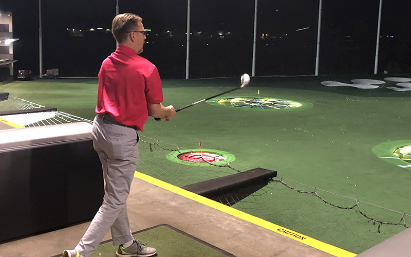 Golfer after hitting a ball at the 2020 Golfathon